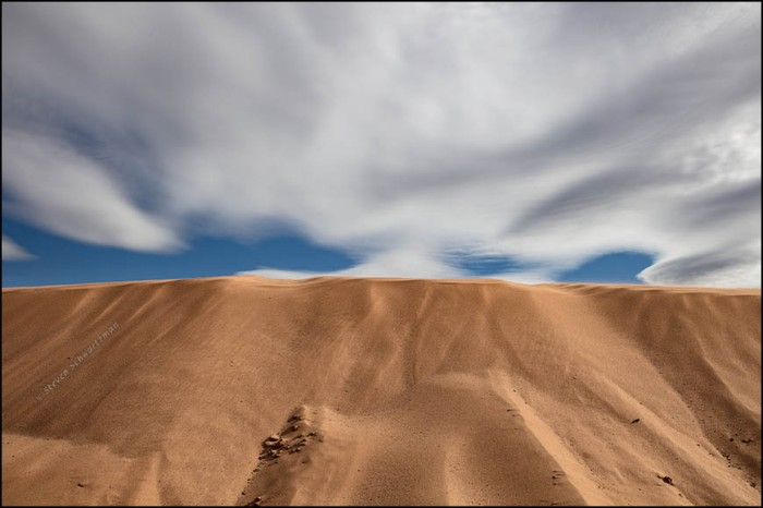 orange-sand-dune-with-clouds-2525